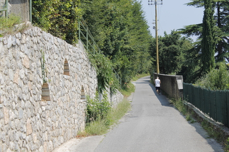 road with ancient wall in north Italy