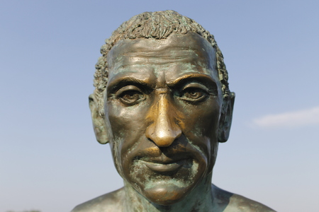 The statue on the Rubicon River celebrates the passage of January 10, 49 BC with the Italian sentence of Julius Caesar meaning the die is cast
