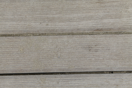 Top view of wooden beach boardwalk with sand