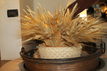 Basket with ears of golden wheat