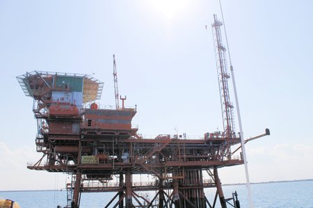 Offshore oil and gas drilling rigs working on new wellhead remote platform for oil and gas exploration and production