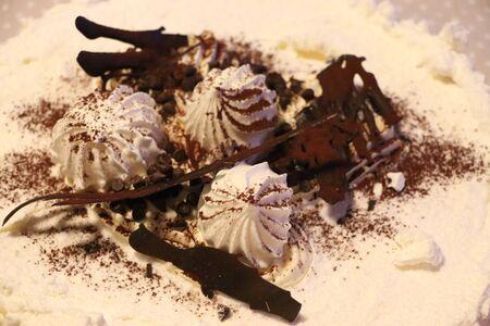 Meringue cake with chocolate cream and healthy food Zdjęcie Seryjne