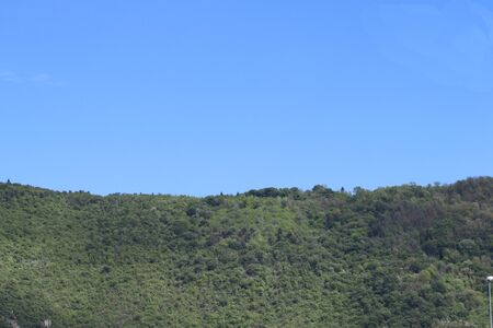 verdant mountains with blue sky in Italy