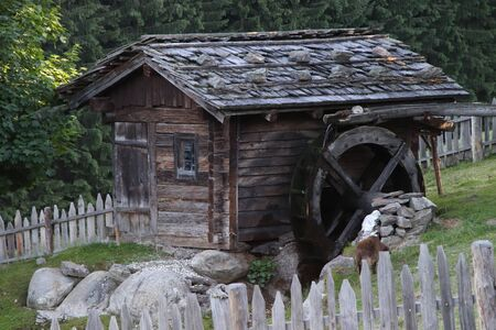 Ancient water mill on the Alps in Italy
