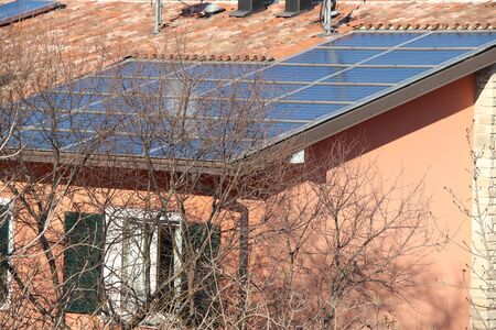 Domestic solar panels catching the sun's rays to power the home