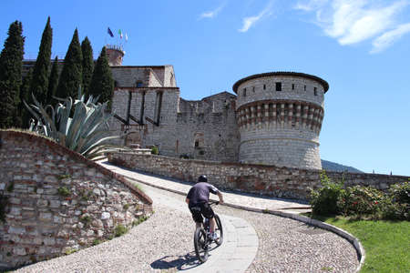 cyclists on the ascent of the castle in Italy