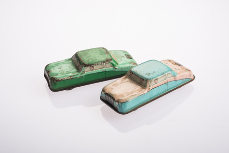tin: Two tin toy cars