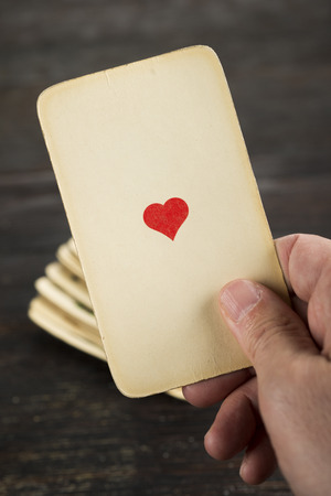 ace of hearts: hand holding ace of hearts catch from the deck