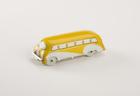 Vintage tin toy car isolated on white.
