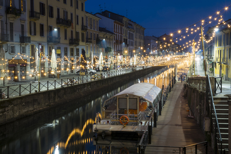Milan, Italy: The Naviglio Grande canal waterway with Christmas light, night view. This district is famous for its restaurants, cafes, pubs and nightlife. Redakční