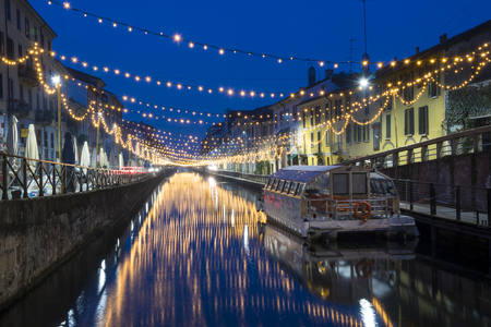 Milan, Italy: The Naviglio Grande canal waterway with Christmas light, night view. This district is famous for its restaurants, cafes, pubs and nightlife. Editorial