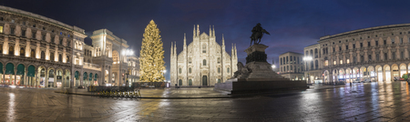 Milan, Italy: Panoramic view of the Cathedral with the illuminated Christmas tree, the Cathedral of the Vittorio Emanuele II Gallery on the left.
