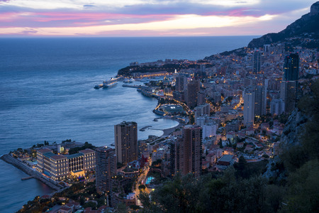 Panoramic view of Monte Carlo in the evening. The Principality of Monaco is situated on a prominent escarpment at the base of the Maritime Alps along the French Riviera. Stock Photo