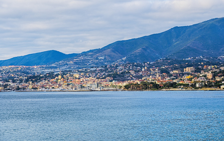 View of the Ligurian coast (Italy, Mediterranean sea) with the city of Sanremo in the background. Italian town festival. This town is famous in the world for the cultivation of flowers.