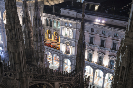 Milan, Italy - January 10, 2018: The Terrazza Aperol restaurant in Piazza Duomo in Milan, Italy. Night view from the Cathedral roof.