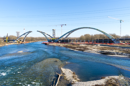 Modern road bridge under construction over the Ticino river in Lombardy, Italy