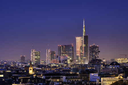 Milan skyline by night, new skyscrapers with colored lights. Italian landscape panorama. Foto de archivo