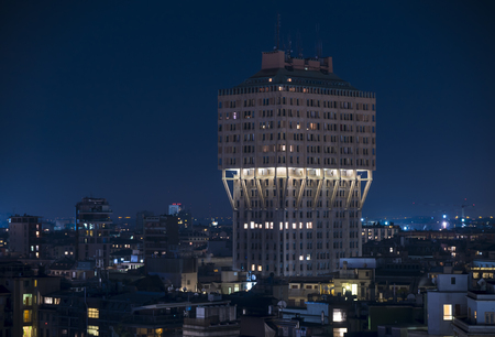 Cityscape of Milan (Italy): The famous skyscraper called Torre Velasca, built in the 50s; night view.
