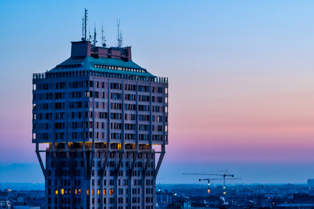 Cityscape of Milan (Italy): The famous skyscraper called Torre Velasca, built in the 50s; sunset view. Editorial