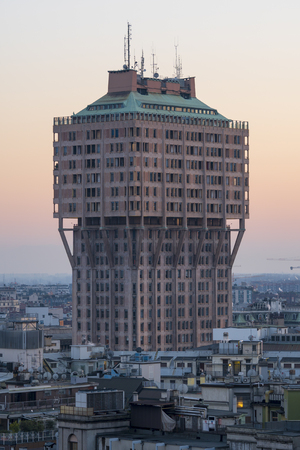 Cityscape of Milan (Italy): The famous skyscraper called Torre Velasca, built in the 50s; sunset view. Banco de Imagens