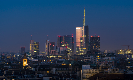 Milan, Italy - January 13, 2018: City skyline at sunset, panoramic view of the Unicredit tower and the other skyscrapers in Porta Nuova district.