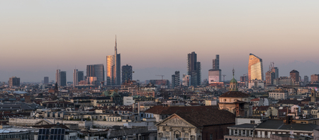 Milan, Italy - January 13, 2018: Milan skyline, panoramic view at sunset. 新聞圖片