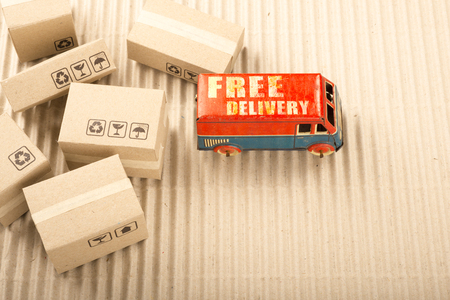 Free delivery van, vintage toy truck with cardboard boxes. Shipping concept. Stock fotó