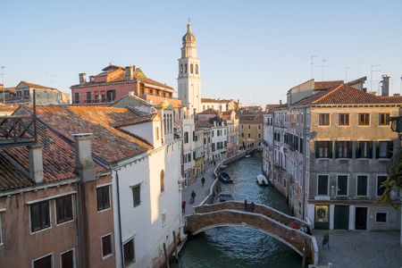 Venice, Italy - March 23, 2018: the canal called Rio della Piet? and the bell tower of the church of Sant'Antonin. View from above at sunset.
