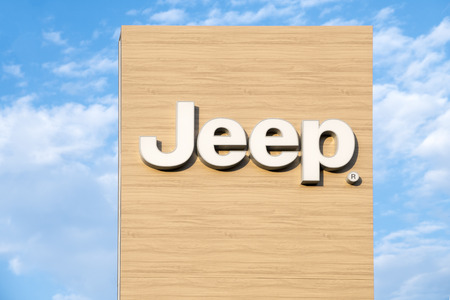 Milan, Italy - April 23, 2018: Jeep dealership logo sign. Jeep is a brand of Fiat Chrysler Automobiles and produces sport utility vehicles and off-road vehicles.