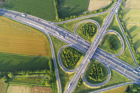 Cloverleaf interchange seen from above. Aerial view of highway and road in the countryside. Birds eye view.