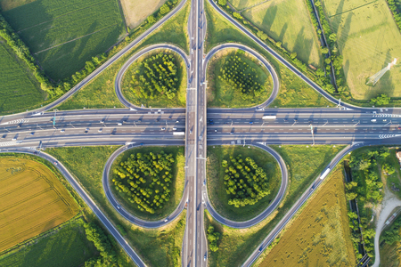 Cloverleaf interchange seen from above. Aerial view of highway and road in the countryside. Bird's eye view.