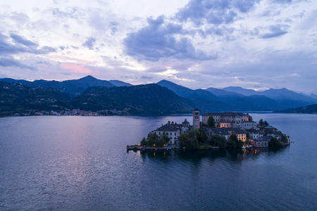 View of San Giulio island at evening, Orta lake, Italy. Aerial view.