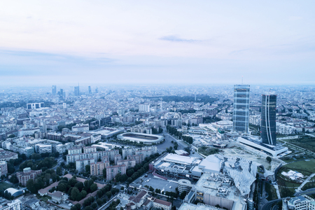 Aerial view of Milan (Italy) at dawn. The two skyscrapers of the City