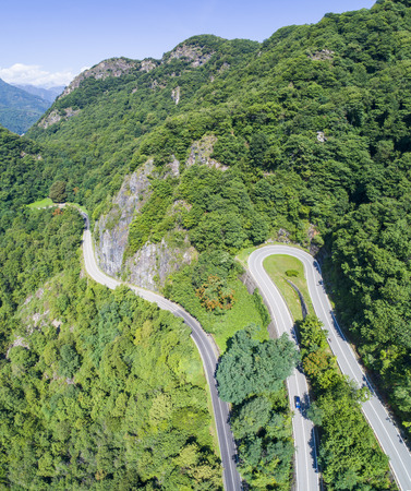 Mountain road in the summer seen from above.