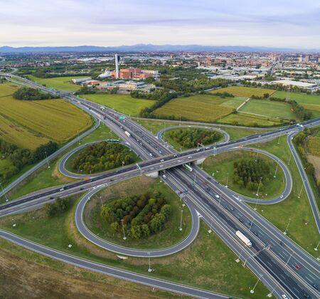 Cloverleaf interchange seen from above. Aerial view of highway road in the countryside. Bird's eye view. 版權商用圖片