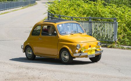 Valsesia, Italy - June 30, 2019: Classic car, a small vintage Fiat 500 during a meeting for historic cars.