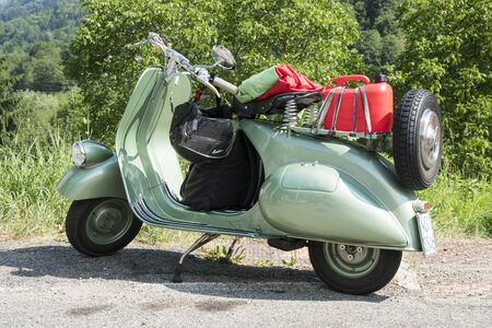 Valsesia, Italy - June 30, 2019: Classic motorbike, a vintage Italian Vespa Piaggio during a meeting for historic vehicles. 新聞圖片