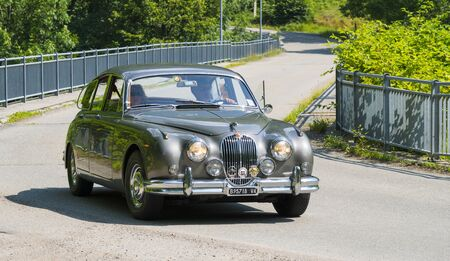 Valsesia, Italy - June 30, 2019: Classic car, a vintage Jaguar during a meeting for historic cars. 新聞圖片