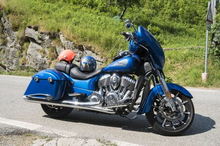 Valsesia, Italy - June 30, 2019: a blue Indian classic motorcycle parked in the street