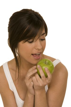 healty: young woman eating a granny smith apple isolated on white