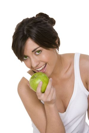granny smith: young girl eating a granny smith apple