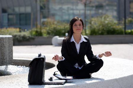 young businesswoman meditating Stock Photo - 3009382