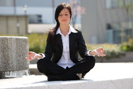 young businesswoman meditating Stock Photo - 3009380