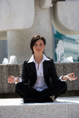 young businesswoman meditating Stock Photo - 3009381