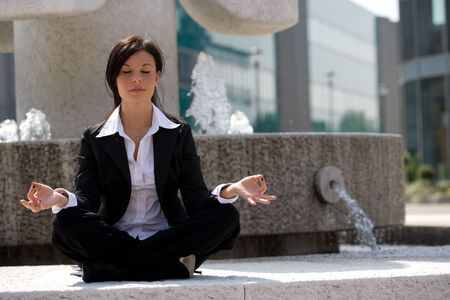 young businesswoman meditating Stock Photo - 3009378