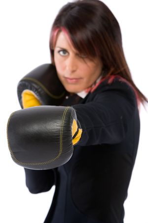A businesswoman with box gloves ready to fight in the office photo