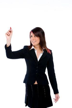 trustable: womann j�venes que buscan las empresas al igual que la escritura en el punto indefinido delante de ella  Foto de archivo