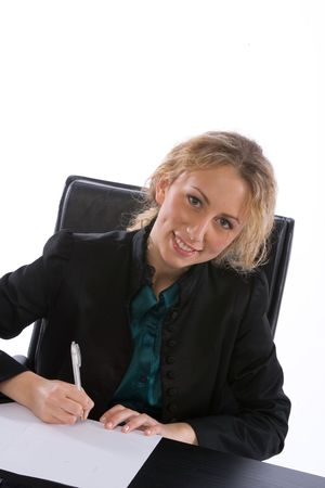 young businesswoman seated sgnign a contract photo