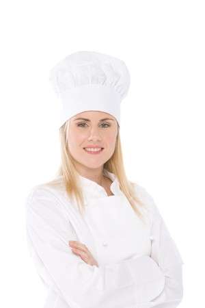 woman chef isolated on white portrait with crossed arms photo