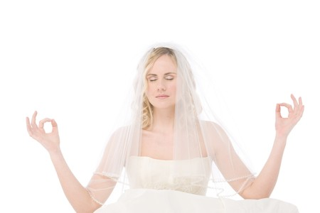 studio shot of a bride isolated on white background doing the zen like position Stock Photo - 4446538